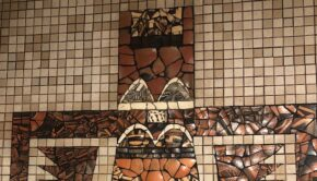 Earth-toned tile mosaic in the shape of a (loosely) Native American kachina figure